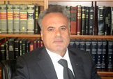 Mr. Andreas S. Petrou